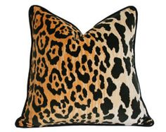 Designer Pillow Cover in this popular leopard fabric very trendy Color: As pictured Fabric: designer fabric Edge: piping Sizes: 12 x 16 x 16 , 18 x 20 x 20 Zippered closure cover only reversable 1 side leopard, 1 side black velvet
