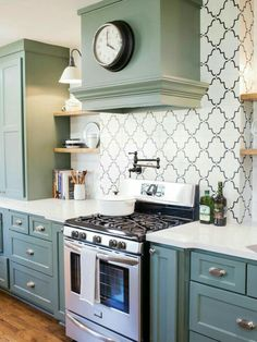Love everything. The cabinet color. The backsplash. The stove. Pretty kitchen.