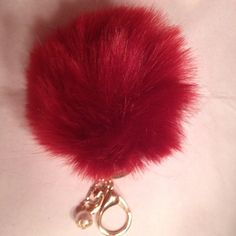 ❤️ Garnet Faux Fur Pom Pom❤️ Beautiful faux fur garnet Pom Pom keychain! Perfect to attach to any purse or your keychain. The hardware is gold and had a pearl accent. You will love this beautiful Pom Pom!! ❤️ Note this is not branded. Only one Garnet Pom Pom is for sale in this listing. Thank you for shopping my closet! None Accessories Key & Card Holders