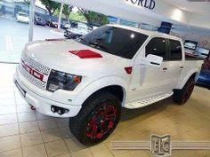 White SVT Ford Raptor red trim offroad truck