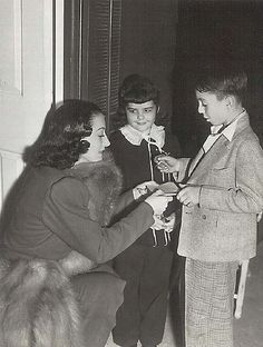 Joan Crawford signing autographs for Our Gang's Darla & Alfalfa.