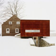 I cannot quite express why this intrigues me, but it does...it is probably the juxtaposition of the snow and bare trees with that wonderful rust-colored cladding.