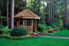 This gazebo serves as an entranceway to the forest beyond the garden. Using a gazebo as a funnel point for traffic can introduce mystique to your garden and a clear transition between spaces.