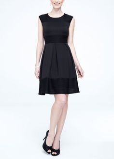 This classic little black dress will sure to become a staple in your wardrobe for years to come!  Sleeveless bodice features stunning ribbon detail on at bust and hemline.  Banded waist accent creates a flattering focal point.  Fully lined. Back zip. Imported polyester/spandex blend. Hand wash cold.