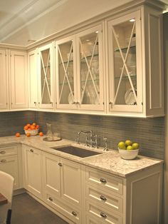 Like the glass cross mullion doors and the backsplash.    (Kitchen by Craft-Maid)