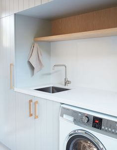 An Easy, Breezy Family Home on Sydney's Northern Beaches Laundry Cupboard, Laundry Cabinets, Laundry Room Shelves, Laundry Room Organization, Laundry In Bathroom, Laundry Closet, Cupboard Doors, Hidden Laundry, Modern Laundry Rooms