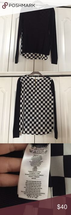 SALE!!!! Michael Kors Long Sleeve Checkered Shirt Michael Kors long sleeve checkered back shirt. Super cute and comfy! Worn one time.. it's navy and the back of the shirt is all checkered while the front is plain navy! So different and is definitely an awesome piece to any closet! Michael Kors Tops Blouses