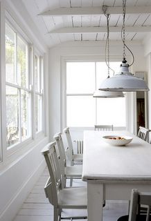 Alabaster house: A white dining area with gorgeous pendant lighting