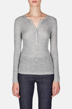 T by Alexander Wang is a source of relaxed yet flattering pieces in a subtle and seasonless palette. Designed to fit close to the body, this long-sleeved henley gains an alluring edge in soft, featherweight wool. With banding at the neckline and cuffs, the finely ribbed pullover is a delicate and versatile layering piece.