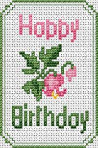 Small cross stitch pattern of a pink flower and a Happy Birthday greeting.