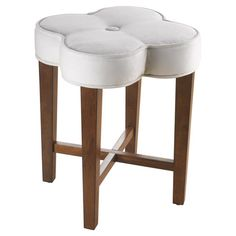 Featuring a clover-shaped top with a button-tufted detail and tapering legs, this fanciful vanity stool brings charming appeal to your master suite or powder...