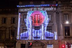 Adam Smith quote projected onto a building in George Street Edinburgh as part of the enLIGHTen project