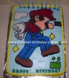 Mario Cake: I made the Super Mario birthday cake for my son's birthday.  I decorated it using Wilton Ready-To-Use Decorator Icing and colored it using Wilton food