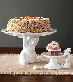 Present your Easter treats with Pier 1's irresistible rabbits. One is hard-working and holds a charming scalloped cake stand—perfect for displaying your favorite sweet creation. The other has a sweet tooth and can't resist sneaking a peek at dessert. Both are crafted from ceramic with a sophisticated antique white finish.
