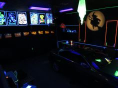 Wow, this guy turned his garage into a black light rec room and has Halloween parties in it.
