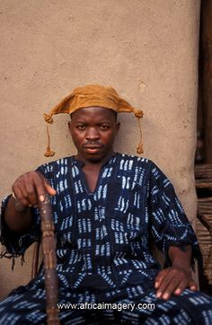 Africa | Dogon man wearing outfit mad from traditional Dogon cloth