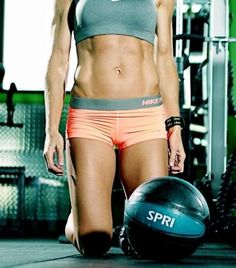 Assault Your Core With The Dynamic Medicine Ball Abs Workout