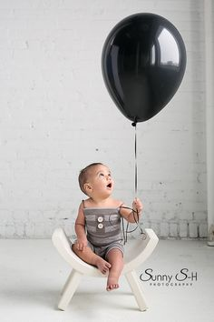 Adorable first birthday studio photo shoot for a baby boy.  Loved the neutral colors and black and white theme.