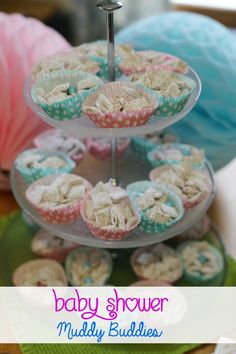 Make baby shower muddy buddies, tuck them into cute cupcake wrappers and arrange them on your table.  Simple and sweet. #client