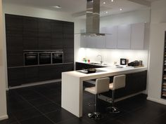 Vetra real glass in white mixed with Rio in basalt oak and corian worktop