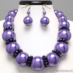 "CHUNKY PURPLE FAUX PEARL HEMATITE TONE METAL NECKLACE SET     * If you need a necklace extender I have them for sale in my store.*        NECKLACE: 17"" + 3"" EXT    CHARM: 1"" LONG    LOBSTER CLAW CLOSURE       HOOK EARRINGS: 2"" LONG           COLOR: HEMATITE TONE  $23.99"