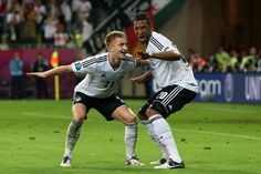 Marco Reus Photos Photos - Marco Reus of Germany celebrates scoring their fourth goal with  Jerome Boateng of Germany during the UEFA EURO 2012 quarter final match between Germany and Greece at The Municipal Stadium on June 22, 2012 in Gdansk, Poland. - UEFA EURO 2012 - Matchday 14 - Pictures Of The Day