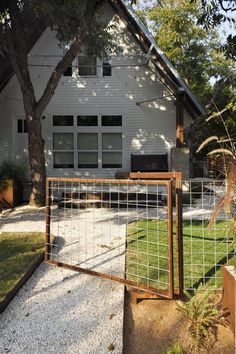 Love this fence. The materials are inexpensive, the lines are clean and it's low maintence. Love this fence for barrier between top yard and bottom yard. Front Yard Fence, Dog Fence, Hog Wire Fence, Chicken Wire Fence, Driveway Gate, Fence Gate, Porches, Outdoor Spaces, Outdoor Living