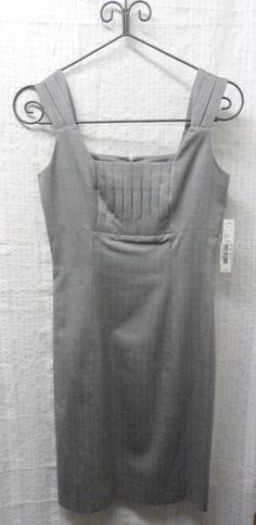 Antonio Melani Light Grey Buttercup Fields Suit Dress Size 2, NWT, Retail $159!  This is a Career Dress from Antonio Melani.      It is light grey, and is accented with pleats at the bust and sleeves.     It sleeveless, and has a small stylish slit in the back.      This is American women's size 2.    http://www.ebay.com/sch/oursisterscloset  http://www.ywcaokc.org/  http://www.facebook.com/OurSistersCloset