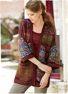 Rich medallions glow from the heathered, striated ground of Kaffe Fassett's gallery-worthy art knit. Hand-loomed in dozens of hues of alpaca (60%) and pima (40%)—from periwinkle, plum and berry to bronze, teal, jade and henna. Generously sized, with drop shoulders, wide ¾-sleeves, patch pockets and striped trim.