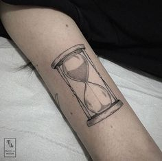 Elegant dotwork hourglass tattoo by Marla Moon