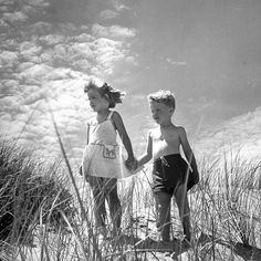 Children on a sand dune in Cape Cod, 1946. (Cornell Capa—The LIFE Picture Collection/Getty Images) #TBT #howisummer Tag your favorite vintage summer photos with #howisummer for a chance to be featured in this feed or our sister brands including @travelandleisure @essencemag @peopleenespanol and many more!
