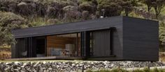 Off-Grid Storm Cottage is a Solar-Powered Timber Box on New Zealand's Great Barrier Island Black Cladding, Timber Cladding, Sawn Timber, External Cladding, House Cladding, Small Buildings, Architect Design, House Painting, Solar Panels