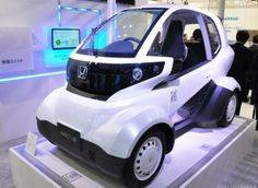 Honda MC-beta | Are super-compact EVs the ride of the future? Japanese automakers continue to experiment with super-small one- or two-seat electric vehicles. But does anyone want to ride these carts? How would you fancy riding around in something that can go 30 miles on a charge and costs around $1?