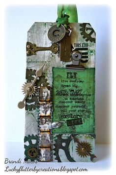 "Handmade tag created using foil tape by Ranger and various metal embellies by Tim Holtz.  I used my Sizzix and ""sprokets"" die to create the grungepaper gears.  The quotes are rub-ons by Tim Holtz and the photos are of my family :-)"
