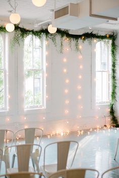 Havens Kitchen / NYC Venue / Photography by Sandy Soohoo Studio / Wedding Photos / New York City / Hanging lights / Cascading greenery / White Walls / Wedding Styling Inspiration / The LANE