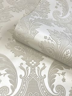 This stunning Amara Damask wallpaper will bring a touch of style and elegance to your home. The design features an intricate embossed damask pattern in a neutral cream tone on a lightly textured pale cream background, with a beautiful soft sheen finish to catch the light. Easy to apply, this high quality vinyl wallpaper would look great as a feature wall or equally good when used to decorate a whole room. Damask Wallpaper, Paper Wallpaper, Vinyl Wallpaper, Colorful Decor, Neutral, Colours, Touch, Cream, Elegant