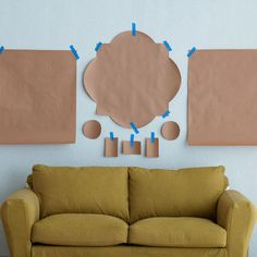 Trace outlines of your objects on sheets of brown paper, and mark where the hangers are located. Group and move the shapes around on the floor until your arrangement feels right. Then use painter's tape to stick the papers on the wall.  This way you'll find the perfect location before you start putting nails in the wall!