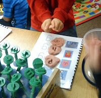 Play doh literacy centre for K classrooms. Kids use letter stamps to create words; shape letters using play doh for tactile learning