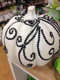white fake pumpkin with black gems glued on