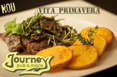 Primavera veal: veal mixed with fresh herbs served with baked potatoes.