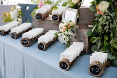 Cute rustic wood escort cards to help guests find their seats displayed on our Spa Linnea Full Length Table Linen. At Homewood Tahoe , West Shore Cafe , by Forget Me Knot Events