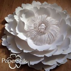 Paper flowers by PaperShik.  And one more flower with another center