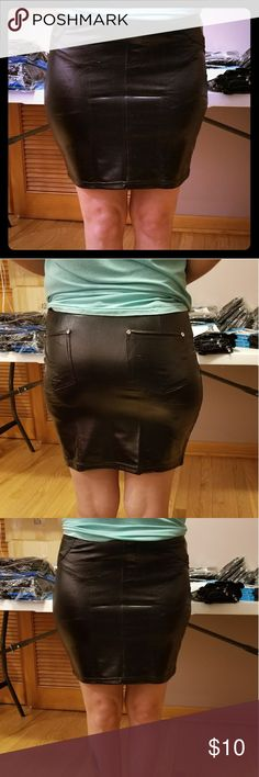 Faux Leather Mini Skirt Faux Leather Mini skirt. Perfect for dressing up or just going out for the night. Machine washable. Hang dry. Polyester/spandex blend. Very comfortable. Indero Skirts Mini
