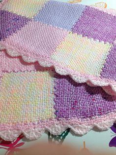 http://www.ravelry.com/projects/NinjaBex/zoom-loom-baby-blanket