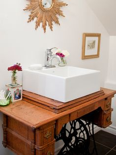 A Singer sewing machine base offered an unexpected detail to this bathroom sink.