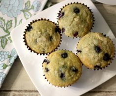 Traditional Blueberry Muffins - A light, fluffy, moist, buttery muffin with a hint of vanilla and chock full of juicy, plump blueberries and only 139 calories each.