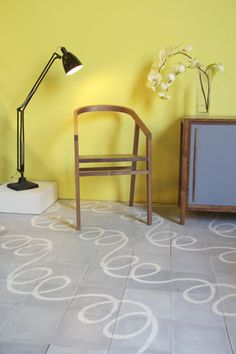 Hate the yellow wall; love the loop-de-loop tile from Popham Design