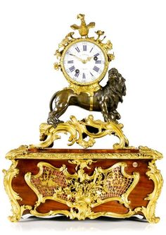 A Louis XV ormolu and patinated bronze mantel clock, French, circa 1745 on an associated casket base | Lot | Sotheby's