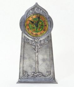 Archibald Knox: Pewter & Enamel Clock, designed for Liberty & Co Ltd ..... via mahala knight