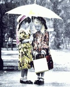 Girlfriends together in the rain